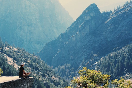 meditating on a mountain